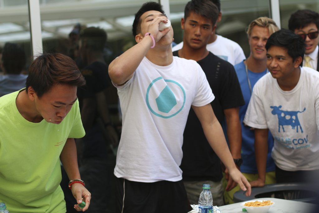 Day 3: Senior Matthew chugs a cup of water to wash down a dry bowl of cornflakes in an eating contest, finishing in first place for the second year in a row.