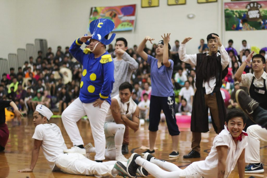 Cap'n Crunch (played by senior Ty Wakabayashi) leads his crew in a dance as part of the seniors' Pepper Squad routine. Even though they came in second place behind the sophomores for this performance, their lead from other events kept them in first place.