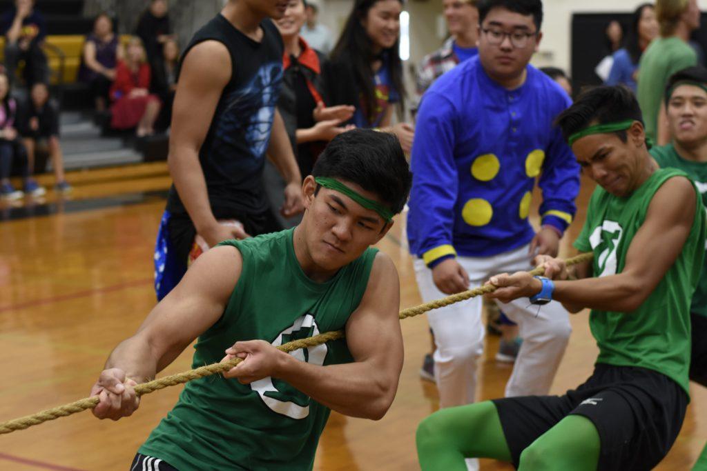 Day 1: Seniors Nathan Hishinuma (left) and fellow Green Lantern Sam Nishimiya lead the senior boys to victory in a close tug of war battle against the junior boys.